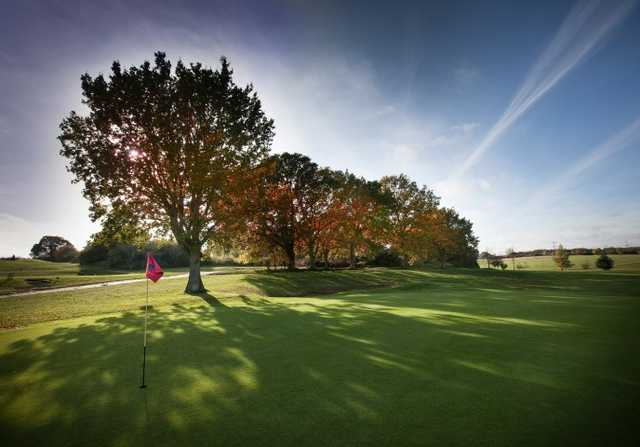 A sunny day view of a hole from Hill Course at Barnham Broom Hotel
