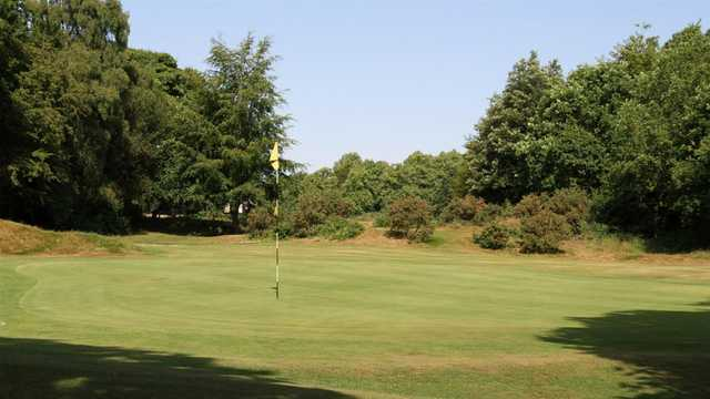 A sunny day view of a hole at Limpsfield Chart Golf Club