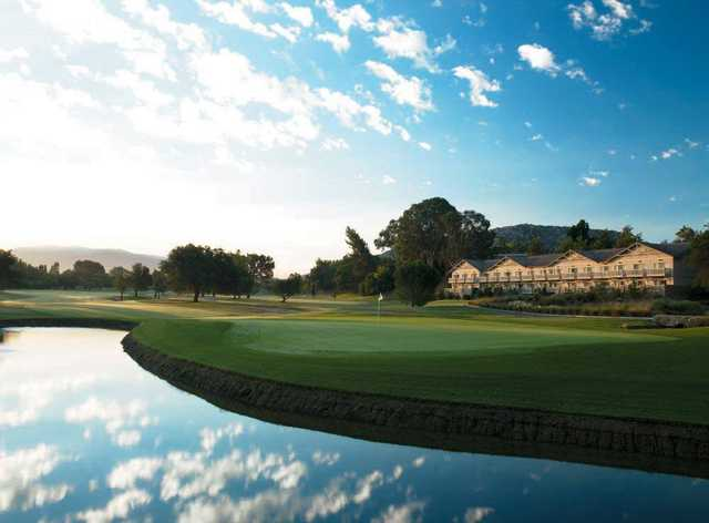 A view of a green surrounded by water at Temecula Creek Inn Golf Resort