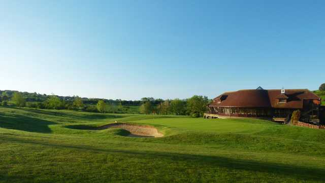 A view of a green and the clubhouse at West Hove Golf Club