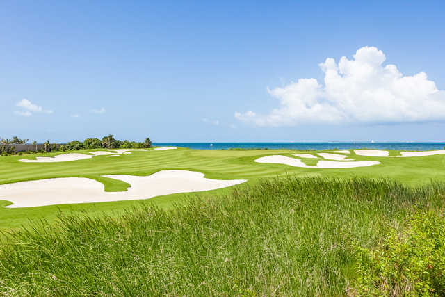 A view of green protected by bunkers from Puerto Cancun Golf Club
