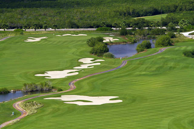 View of a fairway and green at Puerto Cancun Golf Club
