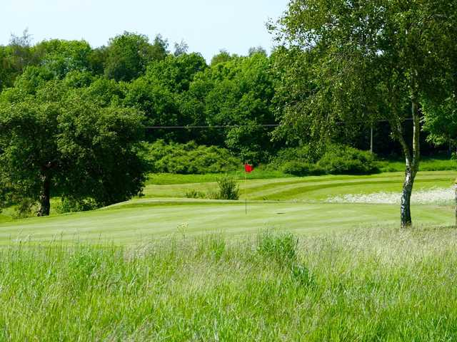 A sunny day view of a hole at Rye Hill Golf Club