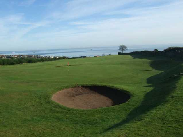 A view of green guarded by bunker at Kinghorn Golf Club