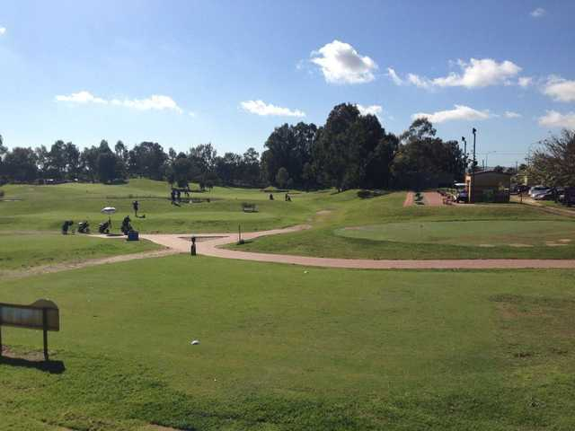 A view of a tee and the practice putting green at Altone Park Golf Course