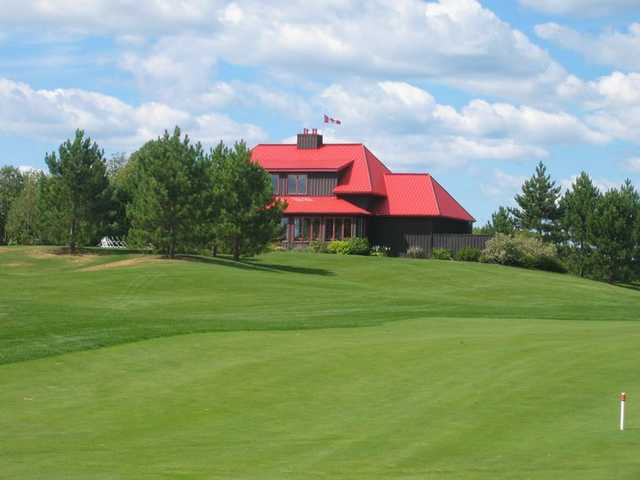 A view of the clubhouse from the 6th fairway at Diamond In The Ruff Golf Club