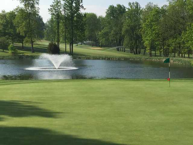 A view of a hole with water coming into play at Golden Oaks Golf Club