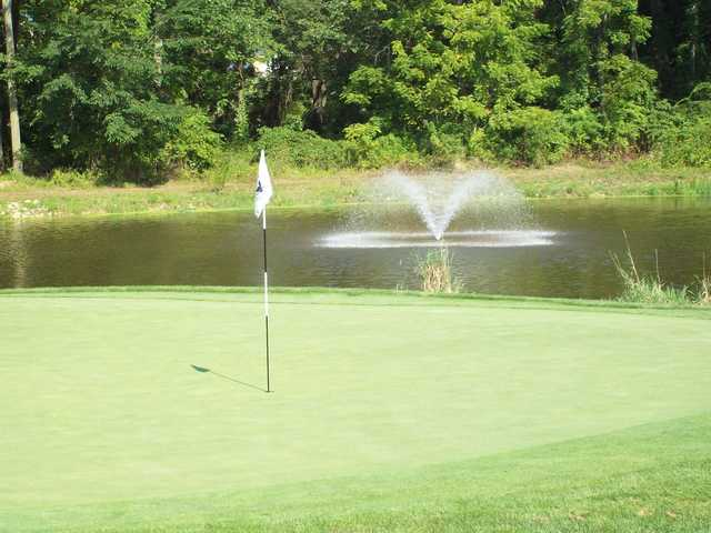 A view of a green with water coming into play at Hickory Valley Golf Club