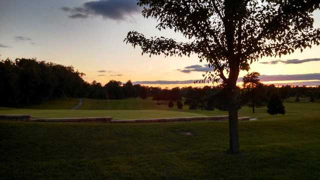 A sunset view of a green at Flatbush Golf Course.