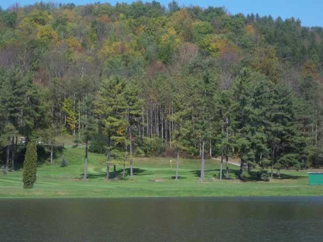 A view of a green with water coming into play at Corey Creek Golf Club