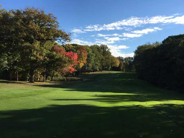 A fall day view from a tee at Lake Isle Country Club