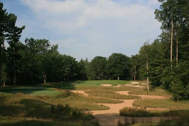 The par-3 fifth hole at Black Lake Golf Club features a waste bunker from tee to green