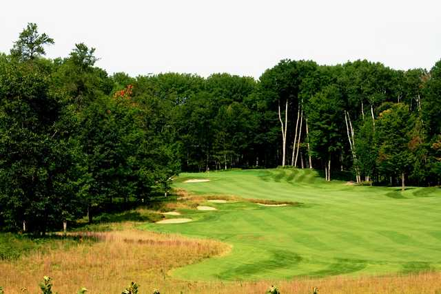 The par-4 13th hole is a long, uphill dogleg left at Black Lake Golf Club