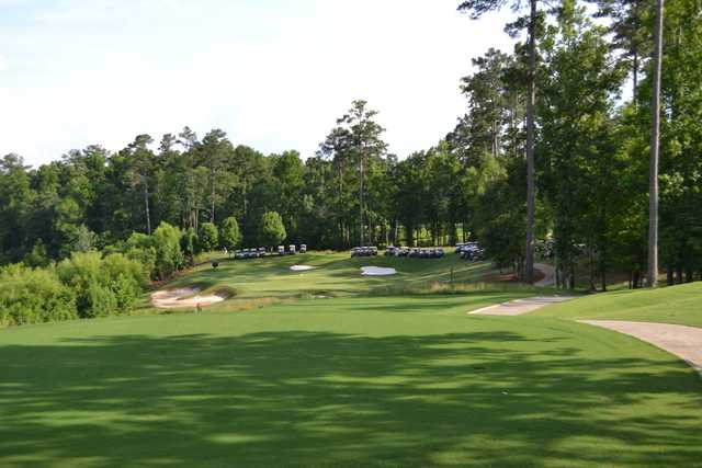 A view of a hole protected by sand traps at Champions Retreat Golf Club