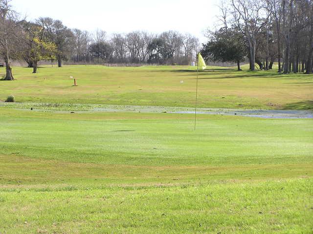 A sunny day view of a green at Rio Colorado Golf Course
