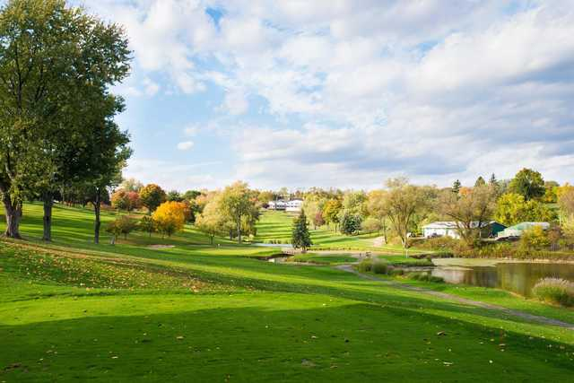 A fall day view of a hole from 3 Lakes Golf Course