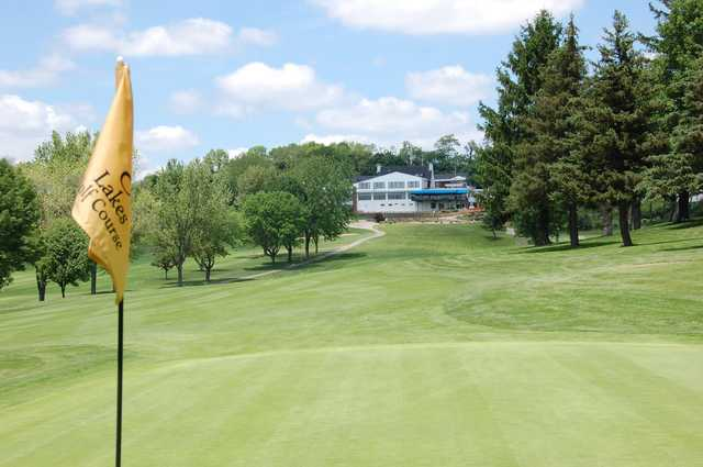 A view from a green of the clubhouse at 3 Lakes Golf Course