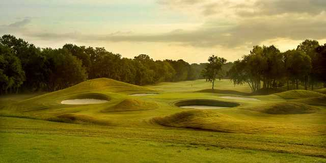 A view of a hole surrounded by a collection of tricky sand traps at Golden Ocala Golf & Equestrian Club
