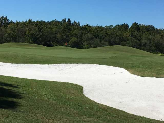 A view of a hole guarded by an undulating bunker at Huntington Hills Golf & Country Club