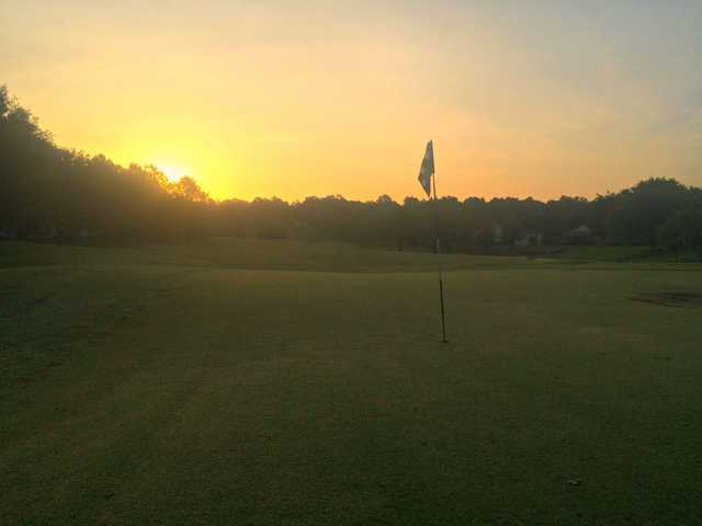 A sunset view of a hole at Kings Ridge Golf Club
