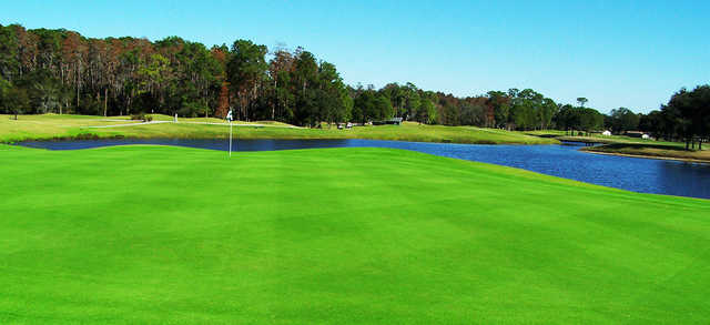 A view of a green with water coming into play at Lansbrook Golf Club