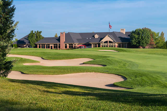 A view of a green and the clubhouse at Prestwick Village Golf Club
