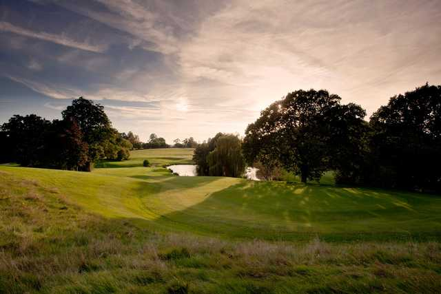 A view of a hole with water in background at Hever Castle Golf Club