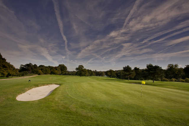 A view of a green protected by a bunker at Hever Castle Golf Club