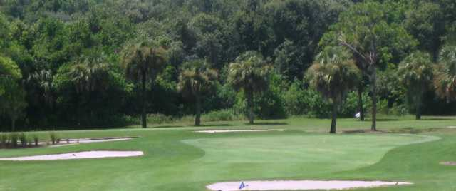 A view of a green protected by tricky bunkers at Tarpon Springs Golf Course
