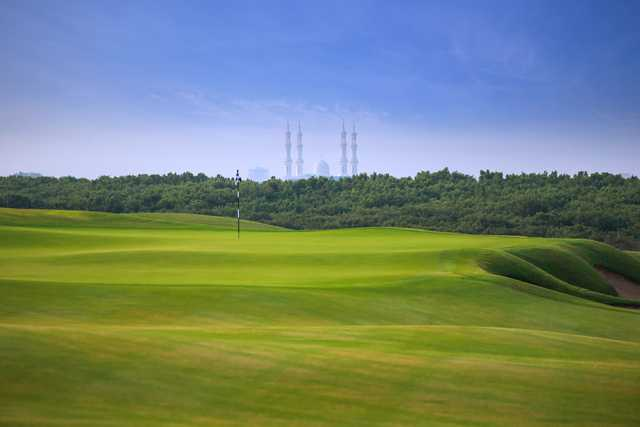 A view of a green at Al Zorah Golf Club