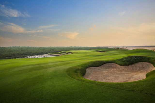 A view of a hole protected by tricky bunkers at Al Zorah Golf Club