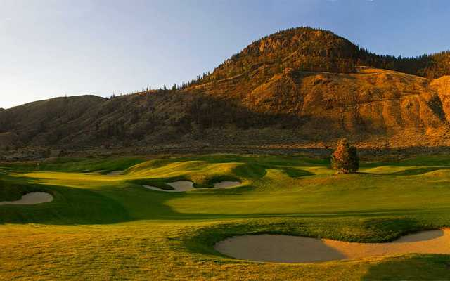A view of a green protected by bunkers at Bighorn Golf & Country Club