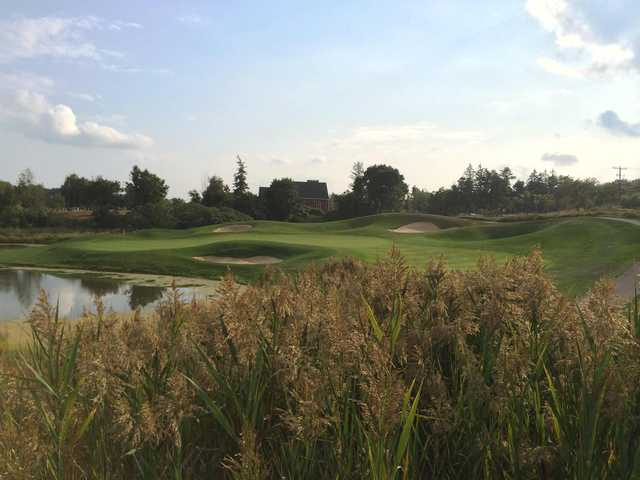 A view of a green protected by bunkers at Willow Valley Golf Course