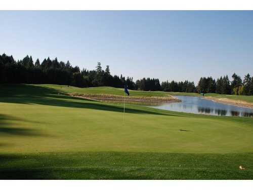 A view of green #16 with water in background at Chehalem Glenn Golf Club