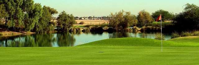 A view of the 9th hole with water in background at Falcon Golf Club