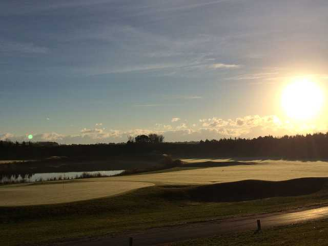A sunny day view of a green at McCullough's Emerald Golf Links