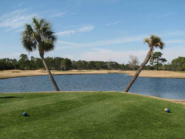 The ninth tee box at Perdido Bay Golf Club in Pensacola, Florida, extends out into a lake.