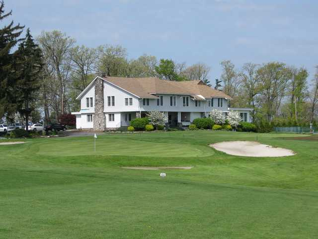 A spring day view of the clubhouse and a hole at Somerset Country Club