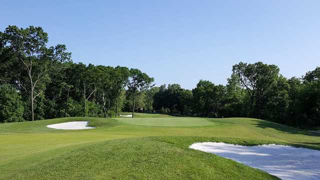 A view of a green protected by bunkers at Keth Memorial Golf Course