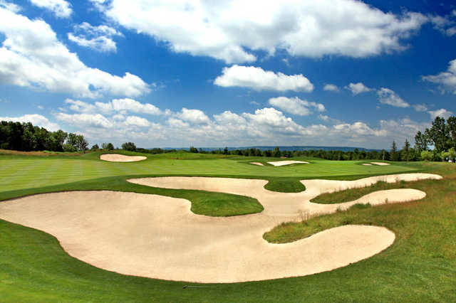 A view of green #1 with bunkers in foreground at Turning Stone - Kaluhyat Golf Club