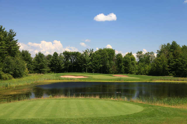 A view of hole #12 with water in foreground at Turning Stone - Shenendoah Golf Club