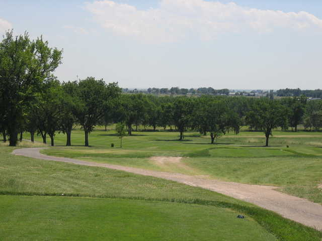 A view of green #3 with narrow road in foreground at Quail Dunes Golf Course