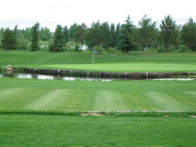 A view of a green with water coming into play at Silver Creek Golf Course