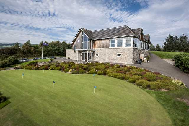 A view of the practice putting green and clubhouse at Alyth Golf Club