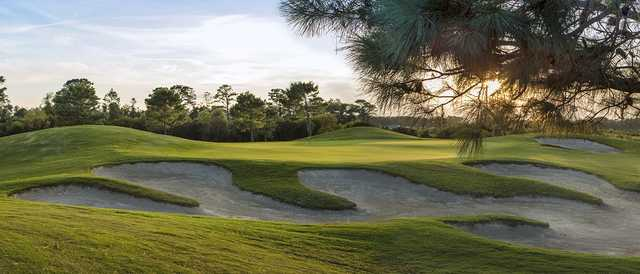 A view of a green protected by undulating bunkers at The Beaufort Club