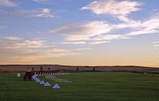 A sunrise view of the driving range at Antler Creek Golf Course