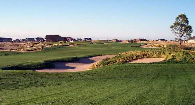 A view of the 14th fairway with bunkers in foreground and green in the back at Antler Creek Golf Course