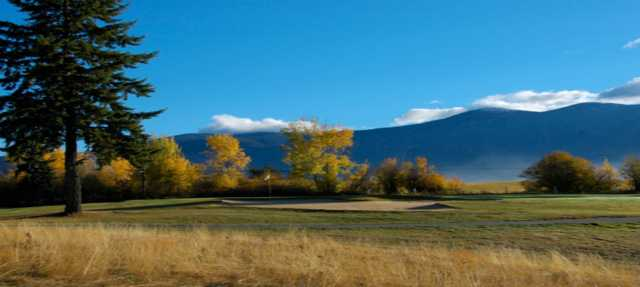 A fall day view of a green at Creston Golf Club