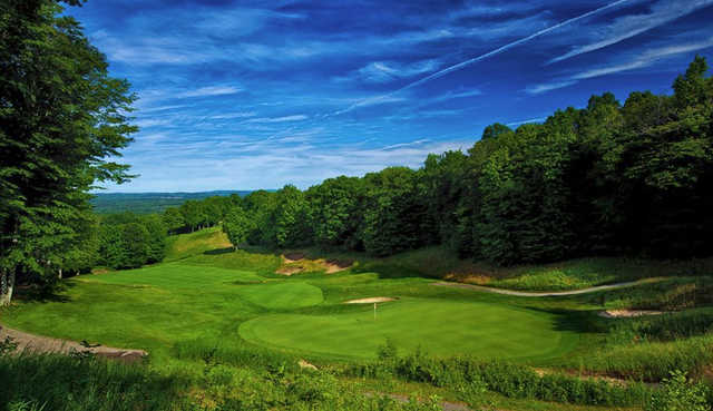 A sunny day view of a hole from The Signature at Treetops Resort