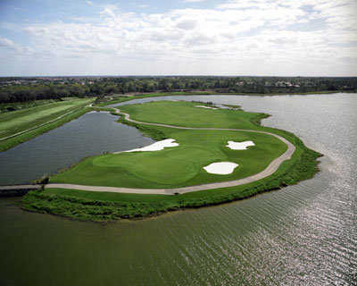 Aerial view of green #3 surrounded by water at Legacy Golf Club